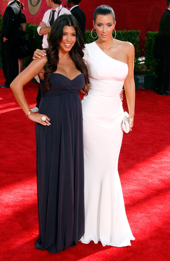 Kim Kardashian and a pregnant Kourtney Kardashian on the red carpet at the 2009 61st Annual Prime Time Emmy Awards