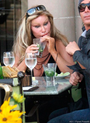 Jocelyn wildenstein and and a mystery man enjoying lunch at the
