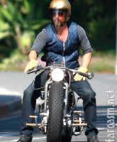 Brad Pitt relaxing on his custom motorcycle
