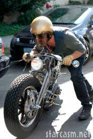 Brad Pitt pushes his wrecked motorcycle