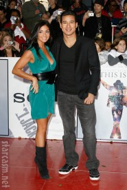 Mario Lopez and a buxom mystery woman at Michael Jackson's This Is It Premiere
