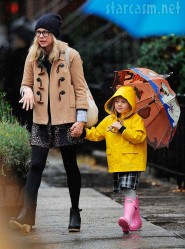 Matilda Ledger and mom Michelle Williams walk to school in the rain