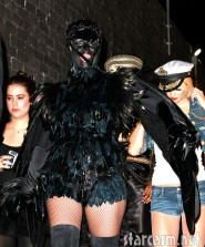Heidi Klum dressed in a crow costume