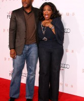 Oprah arriving at the Premiere of Precious in Hollywood with Tyler Perry
