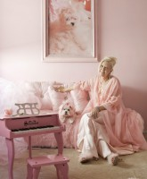 Kitten Kay-Sera relaxes with her pink poodle portrait and pink piano