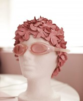 Kitten Kay-Sera's pink swim cap and goggles