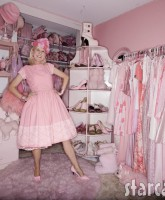 Kitten Kay-Sera in her pink bedroom