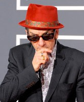 Pimp Elvis Costello in his red fedora