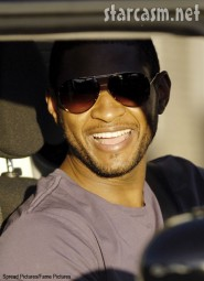 Usher smiles for the paps