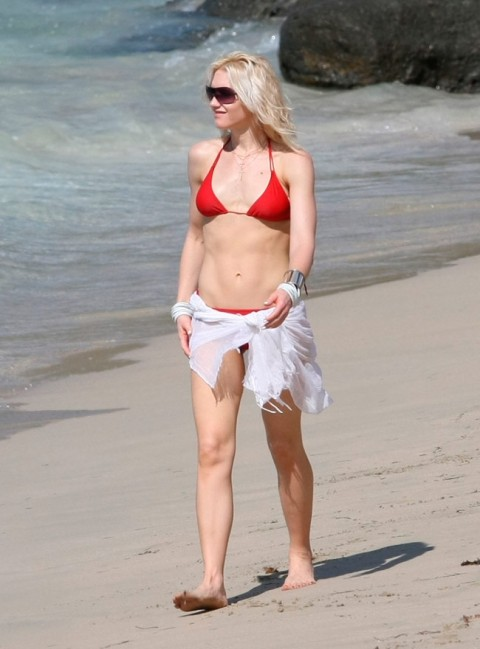 Gwen Stefani shows no sign of having given birth in a small red bikini