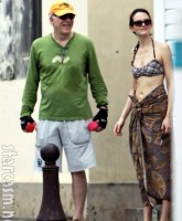 Steve Martin works out while his young wife Anne Stringfield just looks goooood