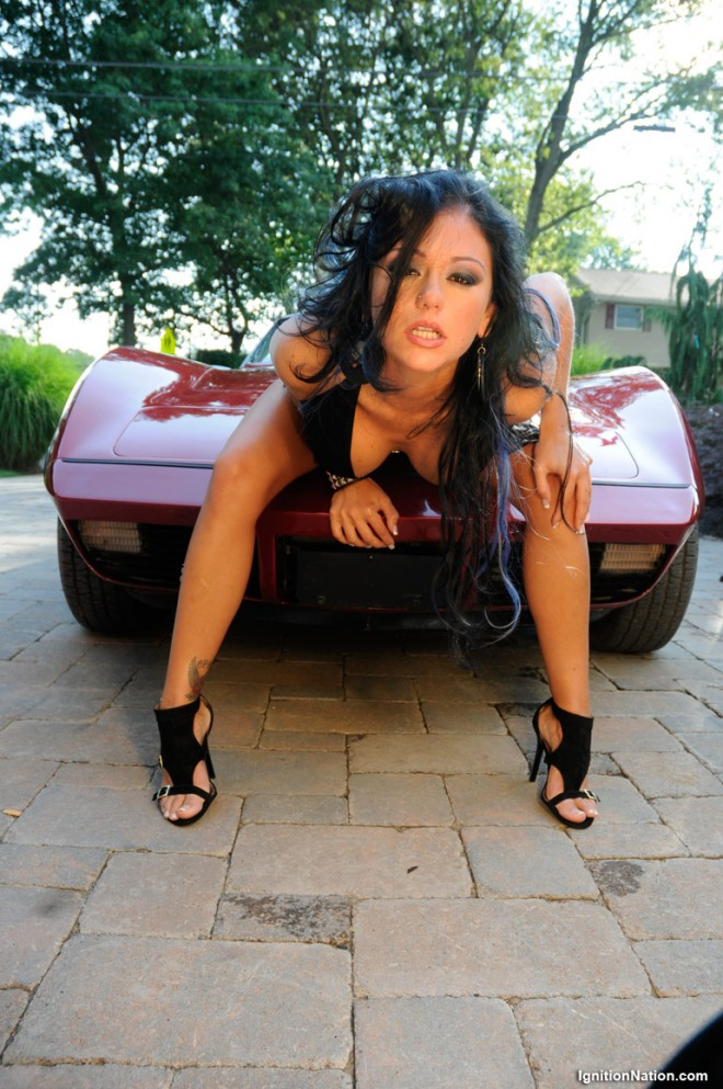 Jersey Shore's JWow Jenny Farley reveals her cleavage while sitting on the hood of a corvette