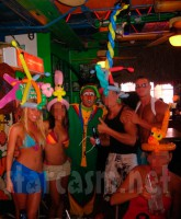 Vienna Girardi from The Bachelor wearing balloons and a bikini at a bar