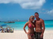 Vienna Girardi from The Bachelor and male companion Brian Lee Smith on the beach