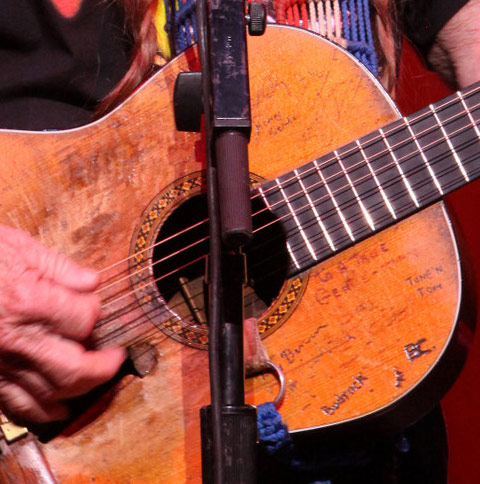 Willie Nelson and some of the signatures on his guitar Trigger