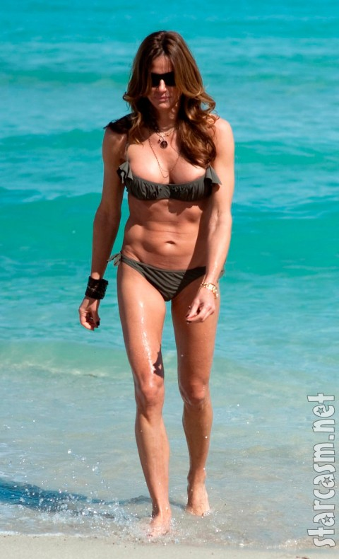 Kelly Bensimon on the beach in a bikini