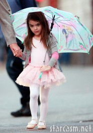 Suri Cruise looking adorable in a ballet tutu and carrying an umbrella Photo 6