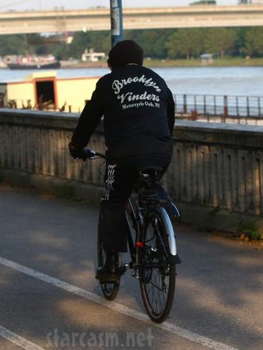 Bob Dylan bicycling in Slovakia wearing a Brooklyn Vinders Motorcycle club jacket