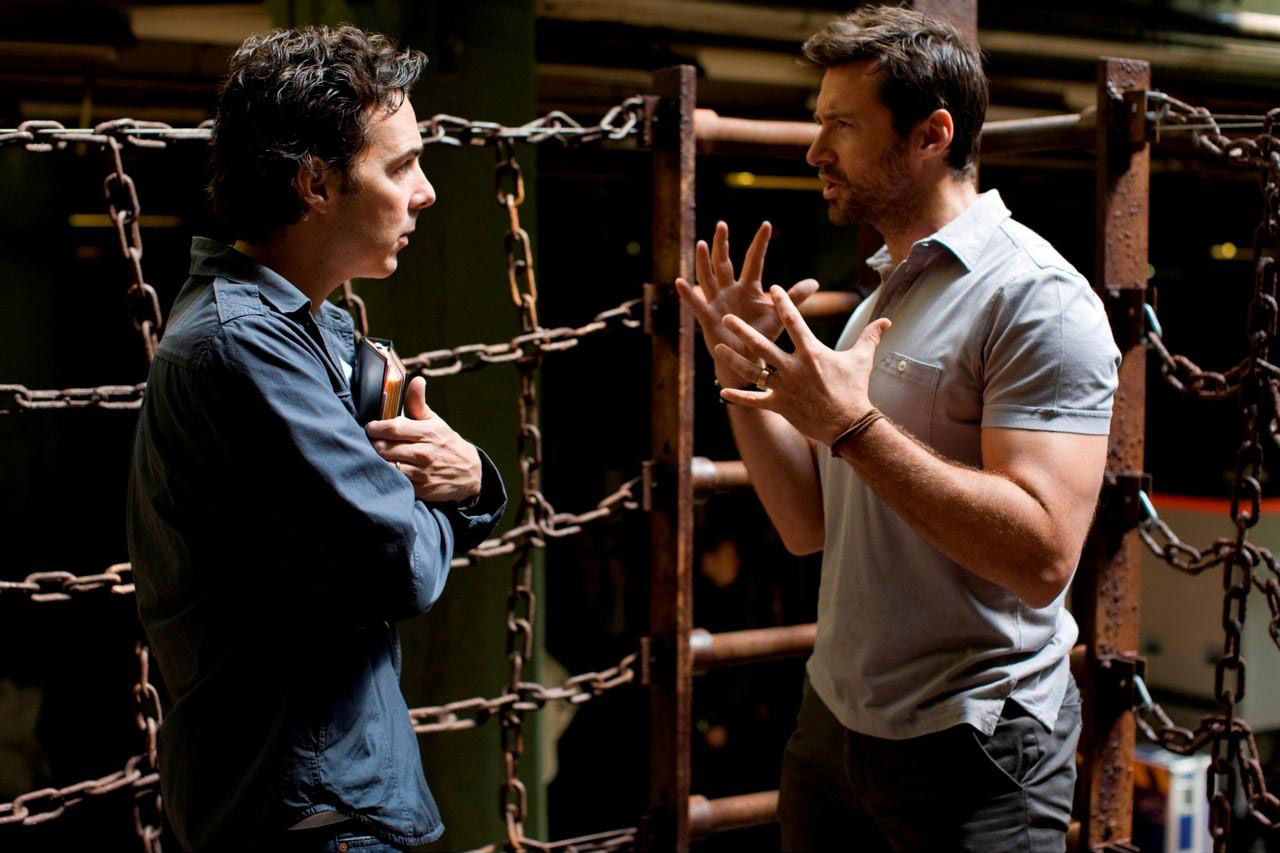 Real Steel director Shawn Levy and Hugh Jackman discuss a scene.
