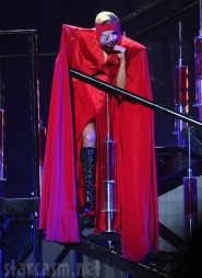 Lady Gaga's wears a red curtain complete with curtain rod