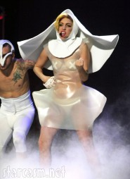 Lady Gaga wears a flying nun comdon outfit on stage
