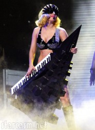 Lady Gaga tickles the ivory on a black geometric Christmas tree keyboard