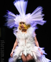 Lady Gaga in an optic fiber lamp costume