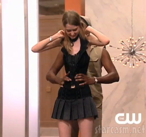 Miss J wraps his hands around the tiny waist of ANTM model Ann Ward from Dallas