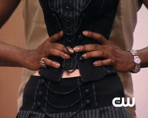 Miss J wraps his hands around the waist of Ann from Dallas on America's Next Top Model