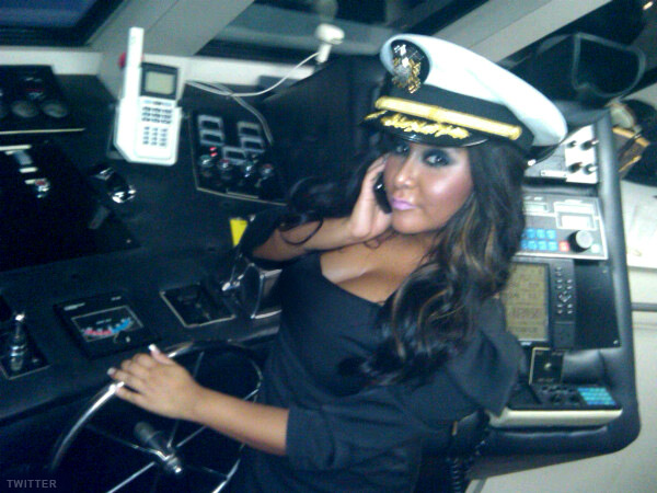 Snooki captains a yacht during the Hampton Chic Launch Party
