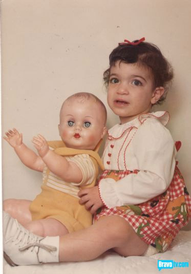 Baby poto of Teresa Giudice with a baby doll