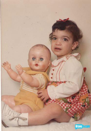 Baby poto of Teresa Giudice with a baby doll