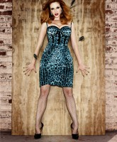 Full-figured Christina Hendricks in a skin-tight animal print dress