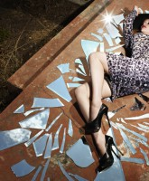 Christina Hendricks lays among broken glass