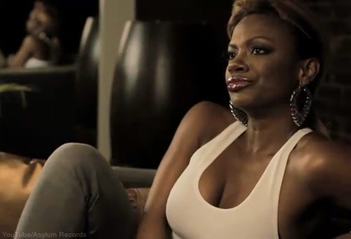 Kandi Burruss in a sexy tank top from the Leave U music video
