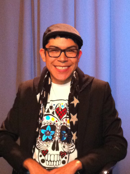 Mondo Guerra wearing his own limited edition Sugar Skull amfAR tee shirt