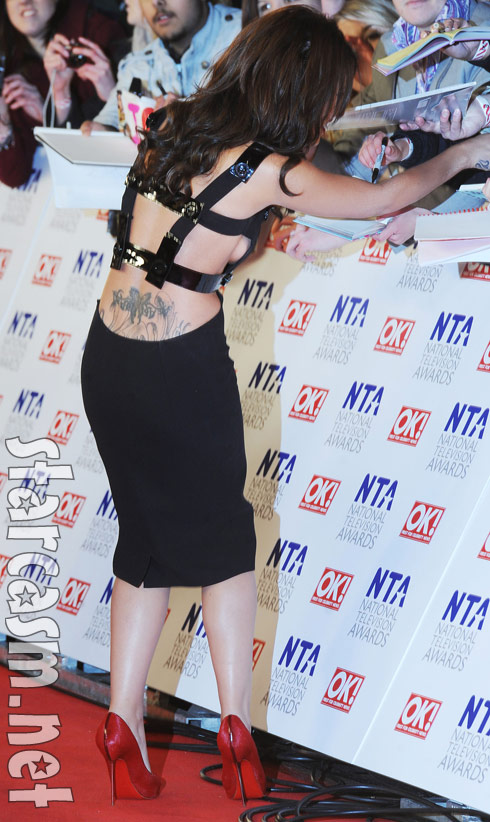 Cheryl Cole reveals new butt tattoo and her breast at 2011 NTAs