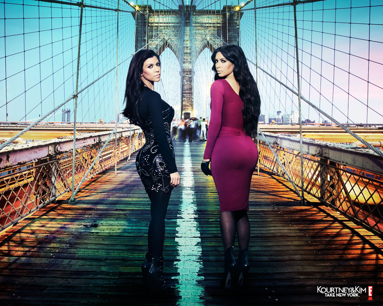 Kourtney Kardashian and Kim Kardashian on a bridge for Kourtney and Kim Take New York