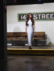 Kim Kardashian wearing a black and white optical illusion dress in a New York City subway