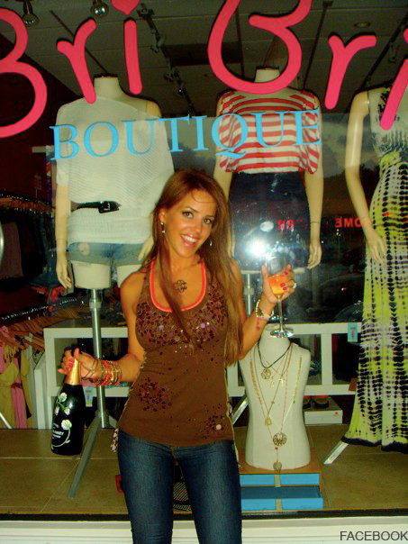 Cristy Rice celebrates in front of her clothing store Bri Bri Boutique