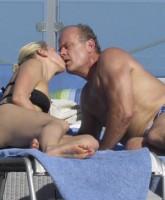 Kelsey Grammer kisses fiancee Kayte Walsh in her bikini