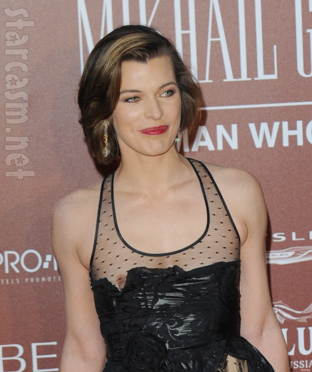 NIP SLIP: Won't Someone Tell Milla Jovovich Her Entire Breast Is Out?