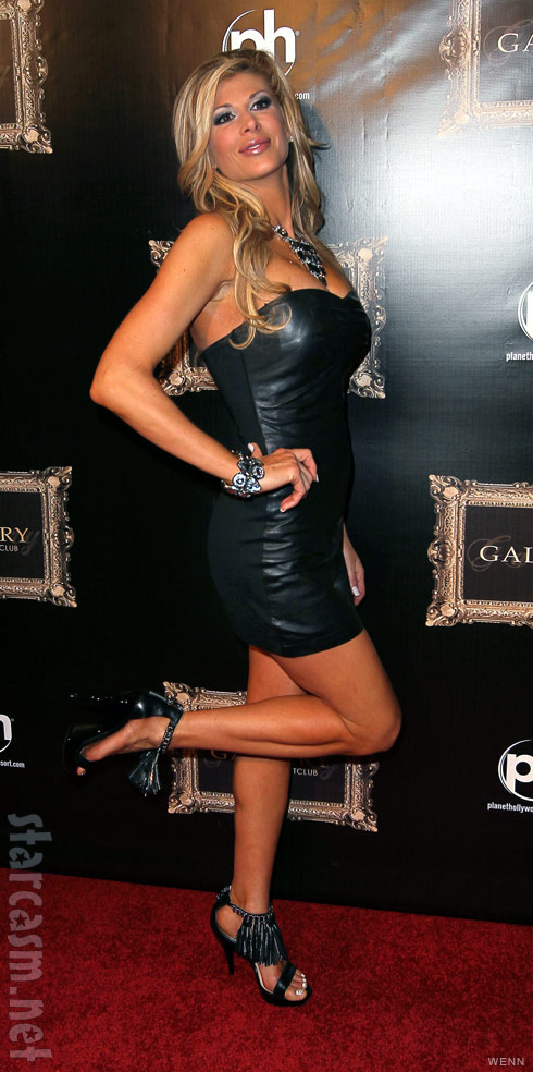 Alexis Bellino in a sexy black leather mini-dress
