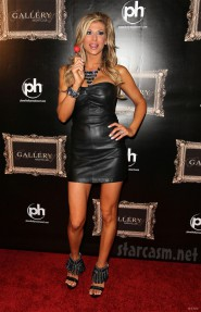 Alexis Bellino wears black leather mini-dress to Gallery Nightclub grand opening
