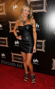 Alexis Bellino on the red carpet in a sexy black leather dress