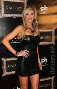RHOC Alexis Bellino wears a leather dress on the red carpet Picture 10 of 12