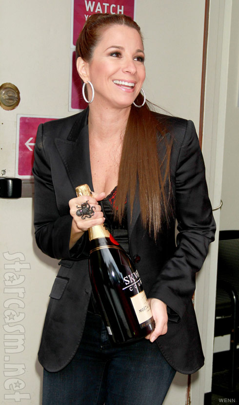 Jill Zarin holds a bottle of champagne after her appearance on The Wendy Williams Show