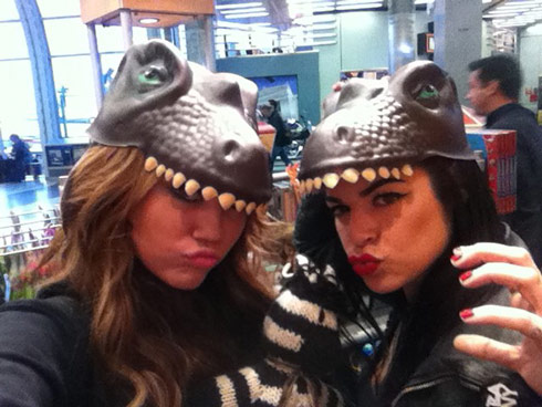 Miley Cyrus wears a dinosaur hat 'RA RA like a dungeon dragon!'