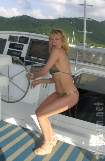 Ramona Singer has fun steering a boat while wearing a bikini