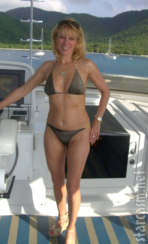 Ramona Singer poses in a bikini aboard a boat